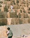 Color close up photograph of people on pyramid in Egypt.